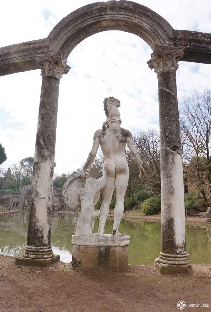 A greek statue on the banks of the Canopus pool of the Villa Adriana in Tivoli