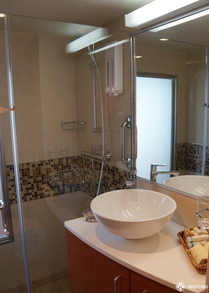 The bathroom and shower inside the staterooms of the Celebrity Xpedition Galapagos luxury cruise ship