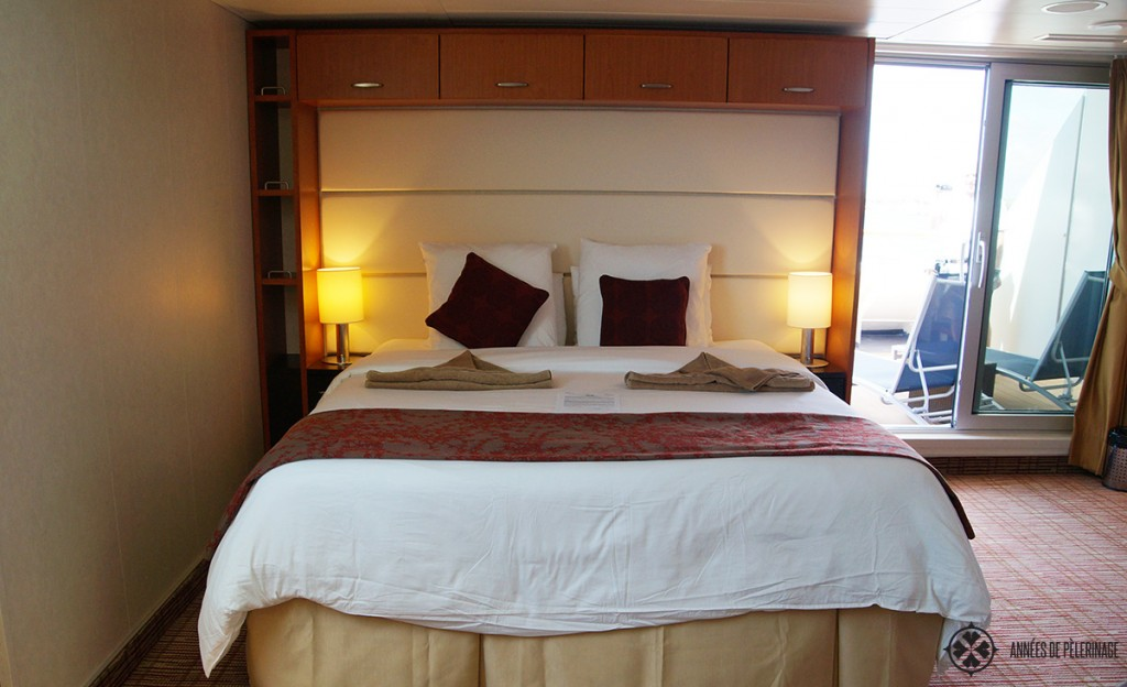 The bed inside the penthouse suite of the Celebrity Xpedition Galapagos luxury cruise ship