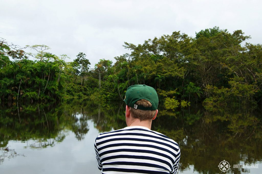 Me on a boat in the Pañacocha Lagoon in Ecuador looking out for pink river dolphins