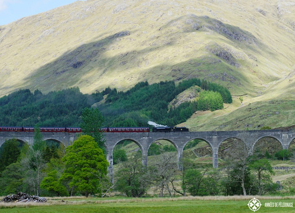 A steam train on the Glenfinan Viaduct near Fort Williams in Scotland