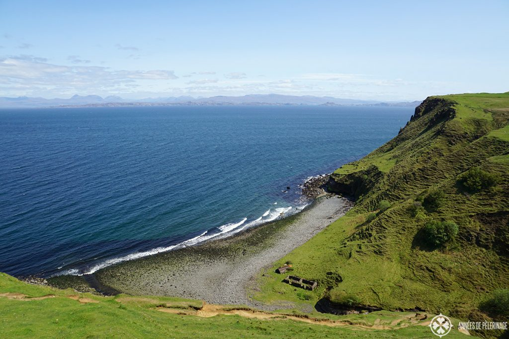 the green bay with its ruined factory buildings near Kilt Rock on the Isle of Skye in Scotland