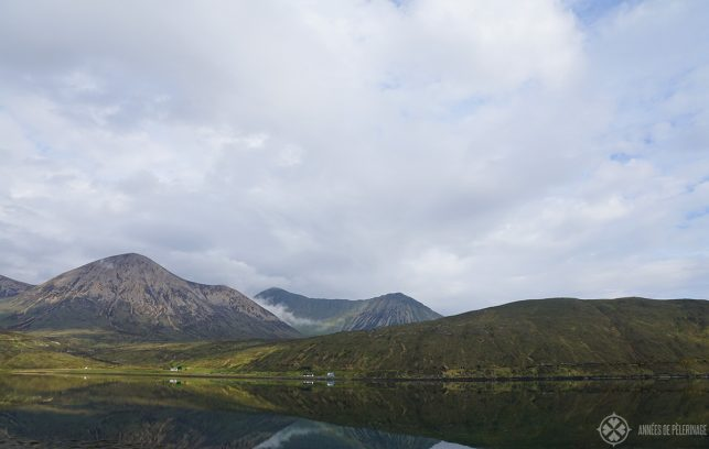A loch perfectly reflecting the equally perfect highland landscape on the Isle of Skye in Scotland