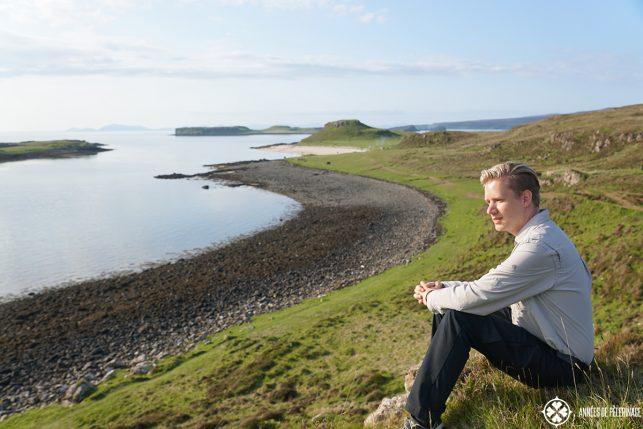 Me sitting at the white coral beach on the Isle of Skye in Scotland. If you are wondering what to pack for Scotland, then know, that you can leave the bathing suit at home.