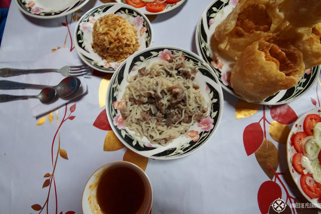 Beshbarmak is the national food of Kyrgyzstan. Traditionally eating with the fingers of the right hand, it tastes a bit like Spaghetti Bolognese