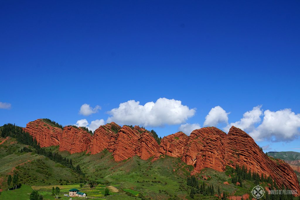 The Seven Bull rock in Jeti-Oguz Kyrgyzstan. Red clay has been weathered down forming these impressive rock formations