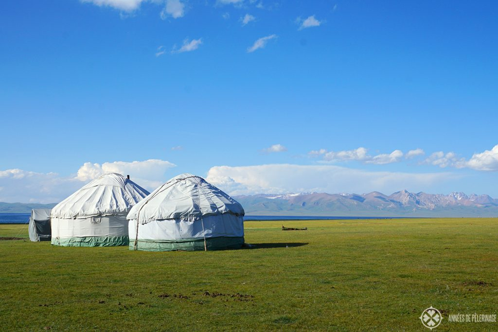 Son-kul lake with two yurts standing near its shore in Kyrgyzstan