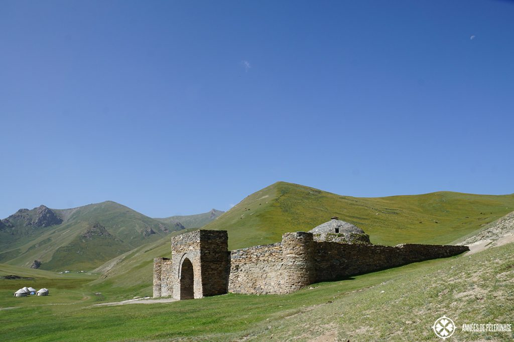 The Tash Rabat Silk Road caravanserai in Kyrgyzstan amd a yurt camp in the background