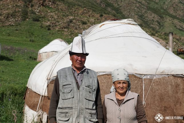 A Kyrgyz couple standing in front of a traditional yurt