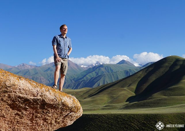 Me standing on a rock an Kyrgyzstan and contemplating my travels around the world