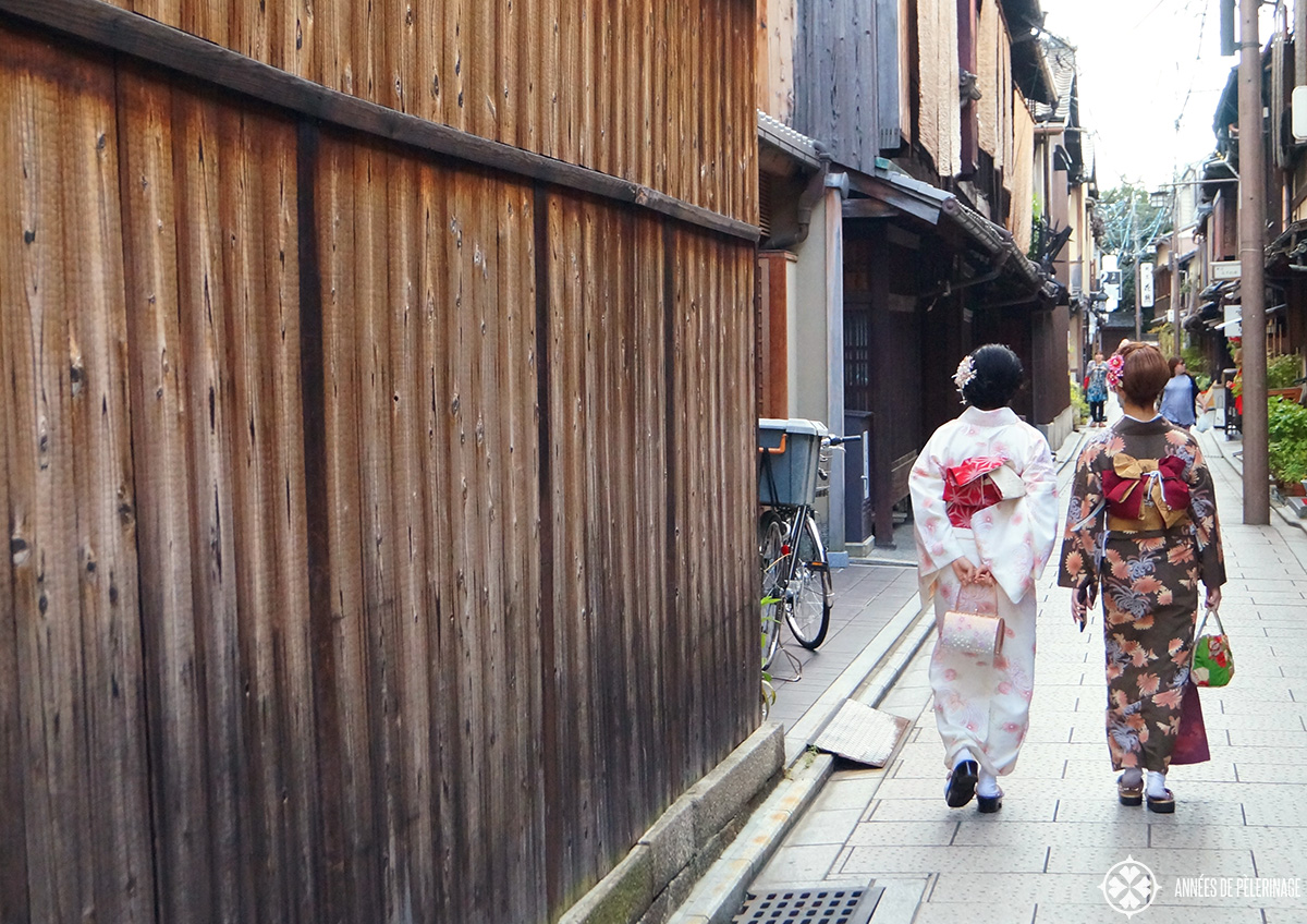 Two japanese women in Kimono walking along the backstreets of the Gion Quarter in Kyoto