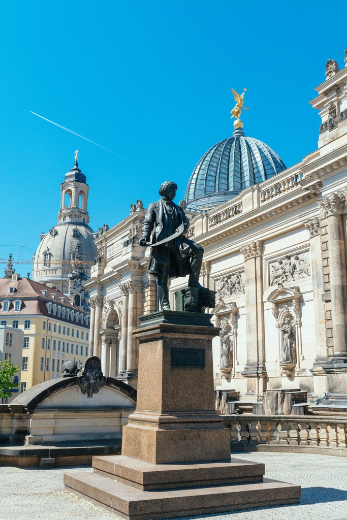 Statue of Gottfried Semper in Dresden Germany with the Frauenkirche in the background