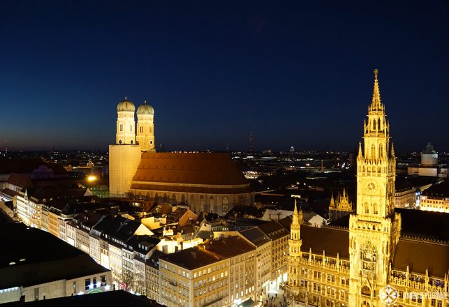 The Frauenkirche in Munich at night as seen from the top of the old pete clock tower