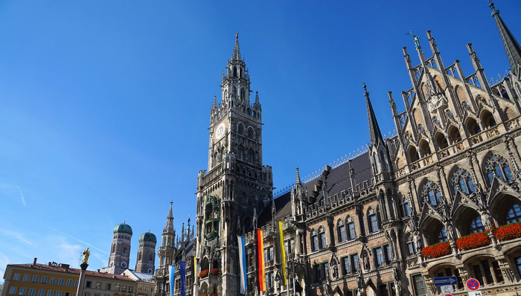 The marienplatz in Munich with its neo-gothic city hall and the frauenkirche in the background