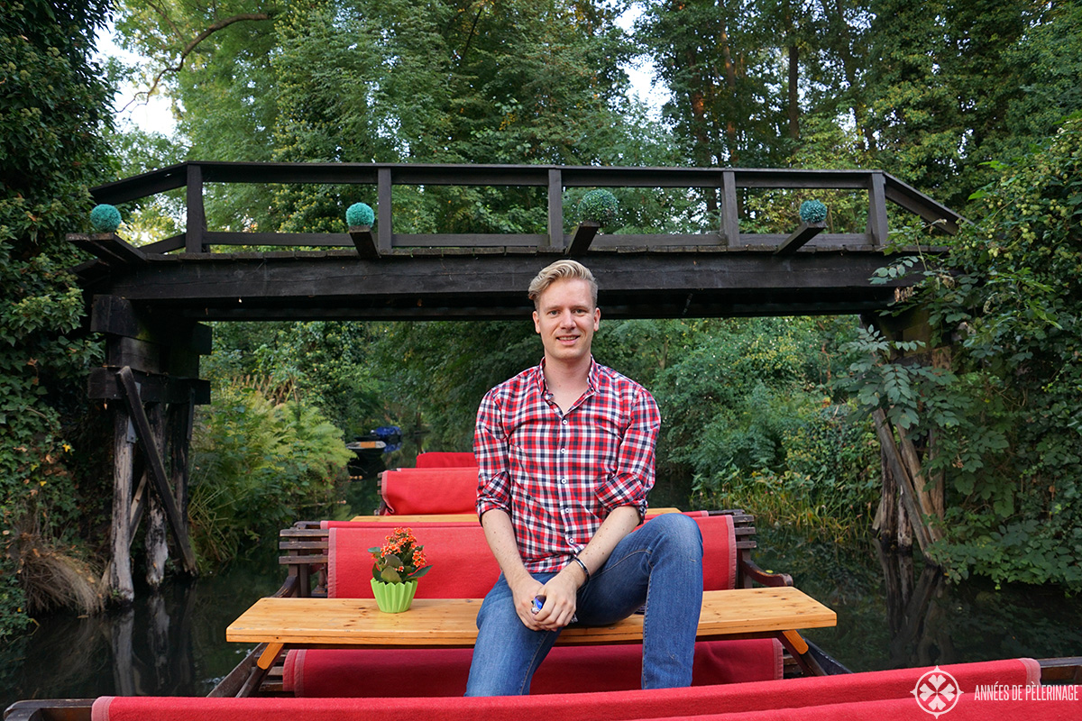 Me sitting on a Spreewald boat and driving through one of the bridges