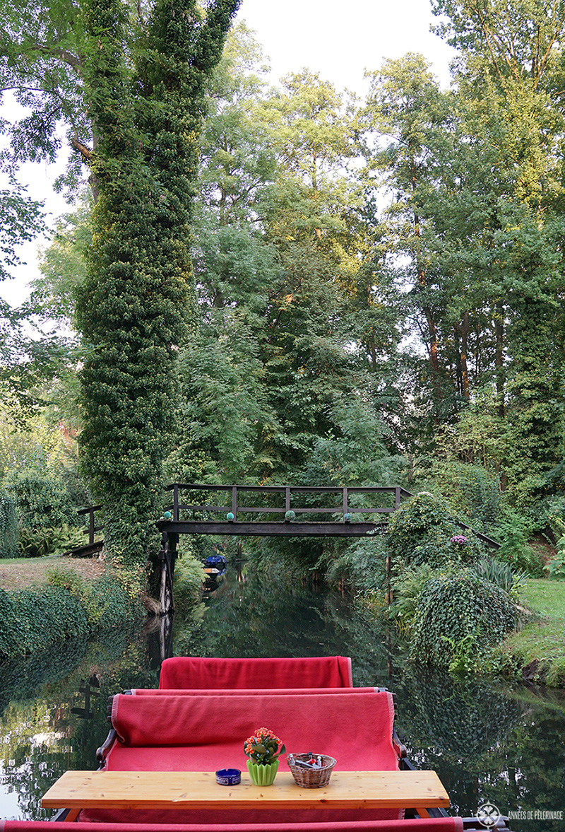 A spreewald boat passing through the many tiny bridges spanning the waterways of the Spree river
