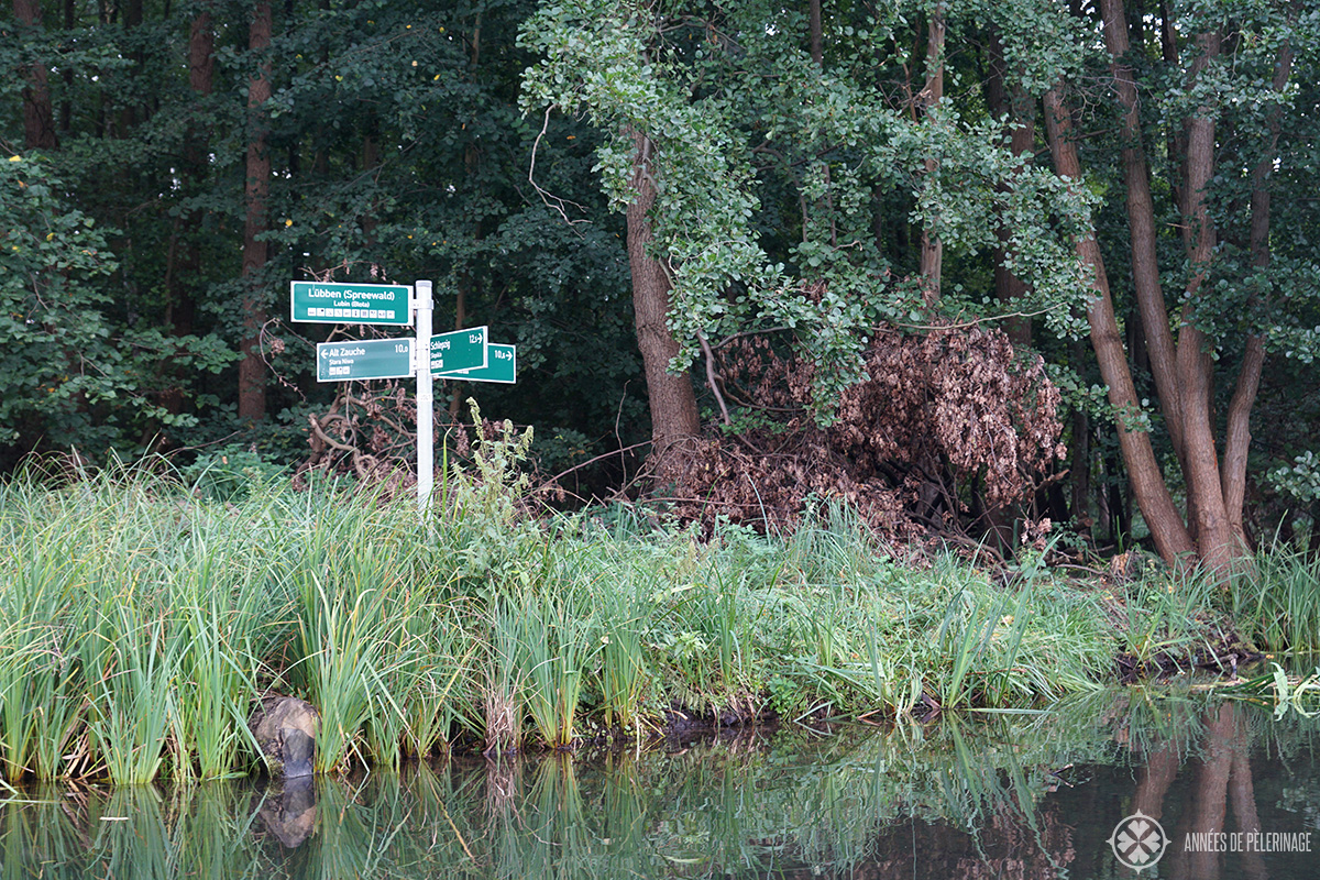 Way signs along the water channels of the Spreewald forest in Germany