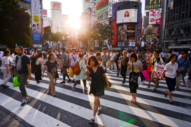 The Shibuya pedestrian crossing as people scramble over it