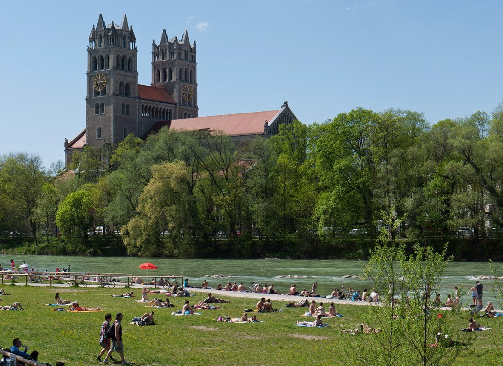 The river Isar in Munich with locals bathing in the sun