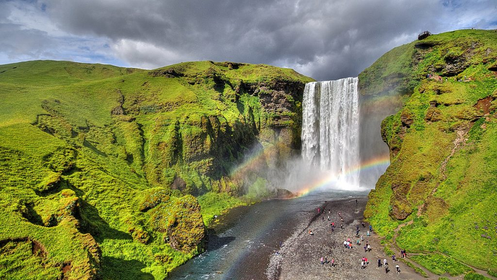 Skogafoss waterfalls in Iceland in summer with two rainbows