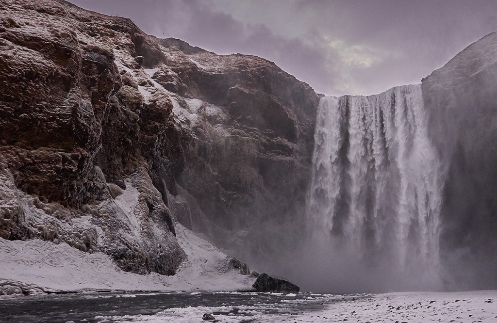 A frozen watrefall in Iceland. Skogafoss is one of the most famous waterfalls
