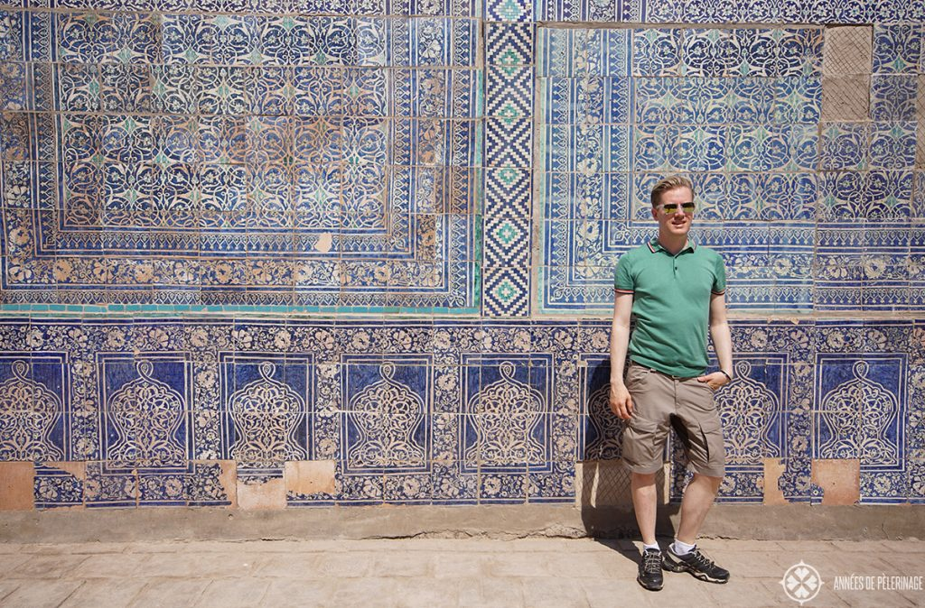 Me standing in front of wall with blue tiles in Khiva, Uzbekistan