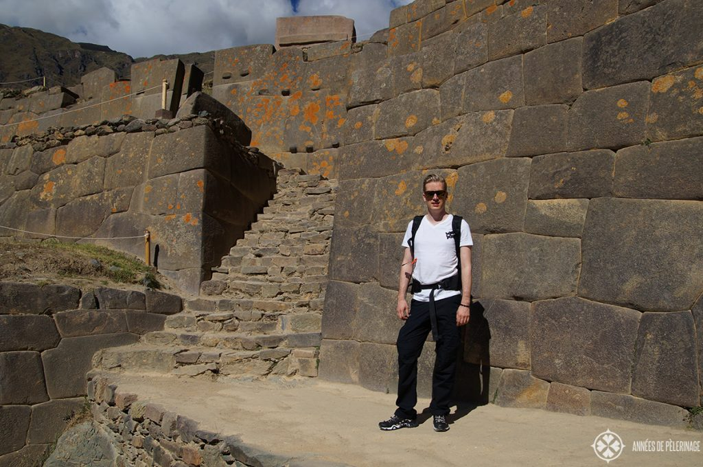 Me standing in front of a perfect stonework wall in Ollantaytambo, Peru