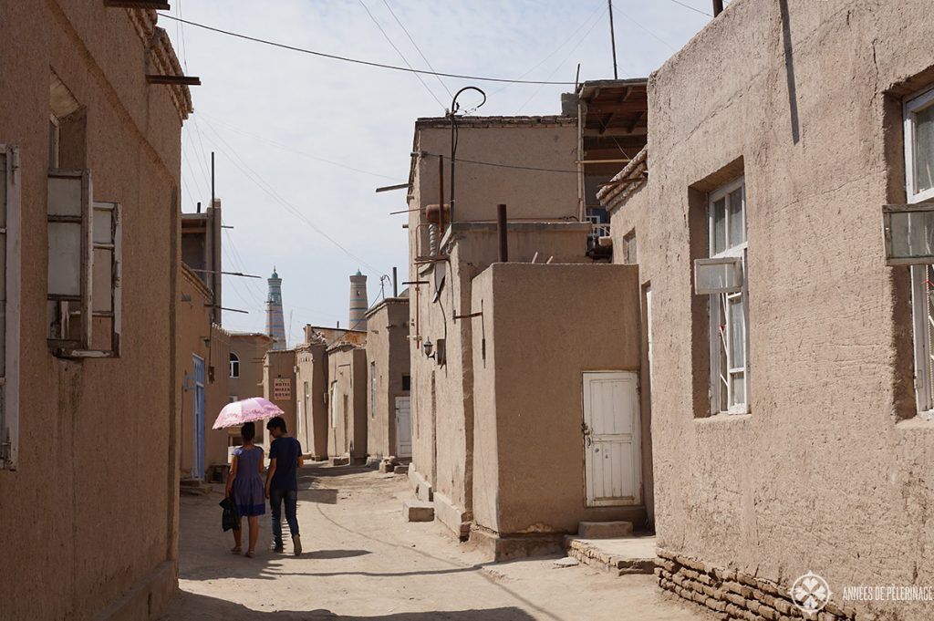 two young locals walking along the streets in Khiva, Uzbekistan