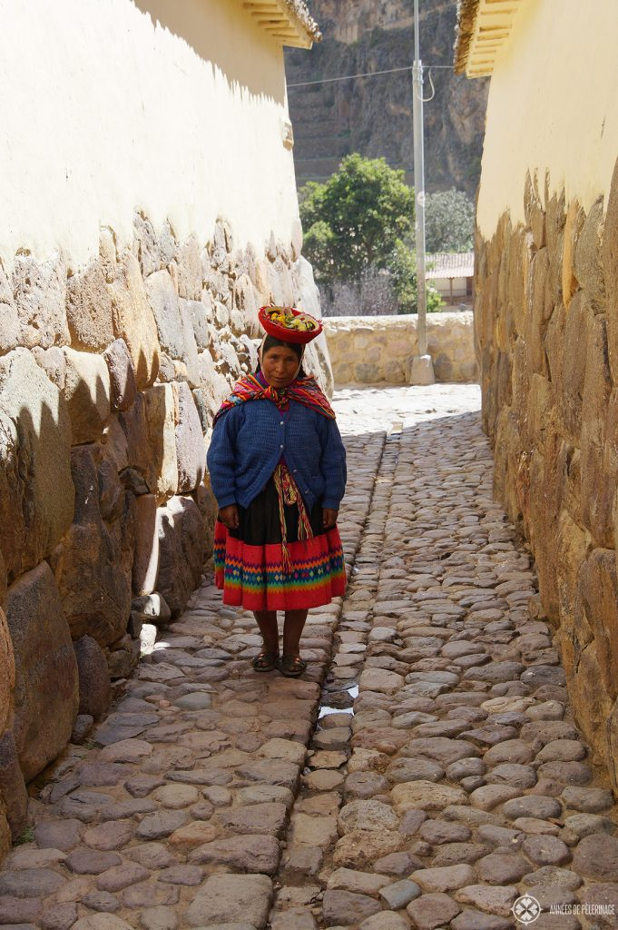 A woman in traditional Peruvian clothes in the old town of Ollantaytambo, Peru