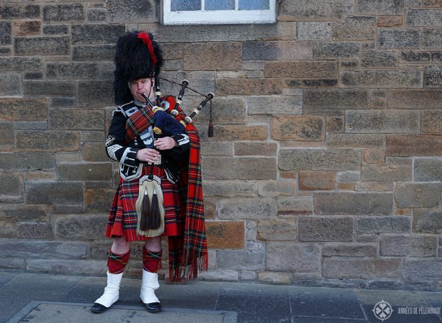 a bag pipe player on the Royal Mile in Edinburgh Scotland