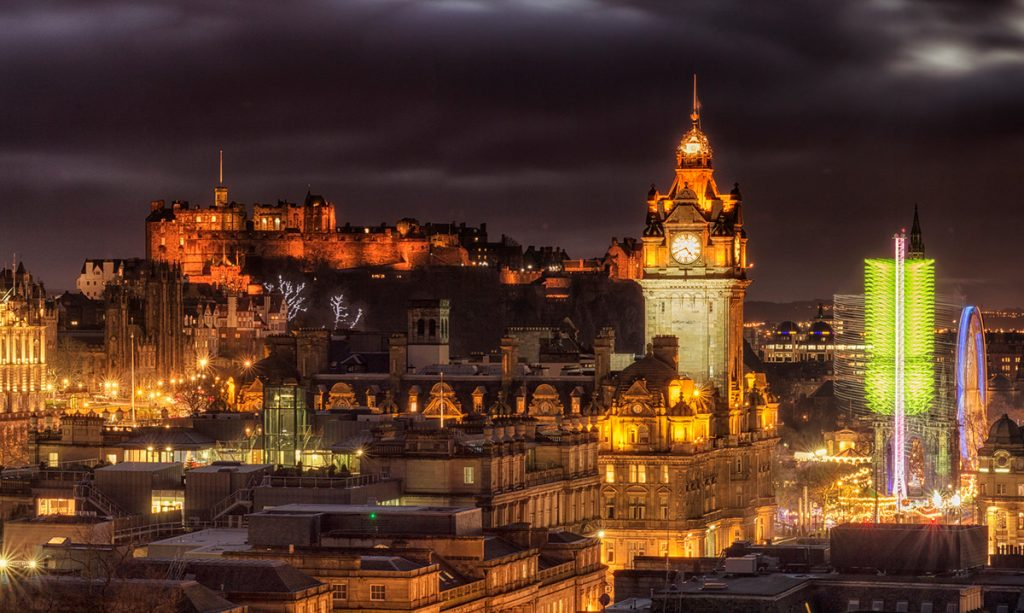 The clock tower of the Balmoral Luxury hotel in Edinburgh at night