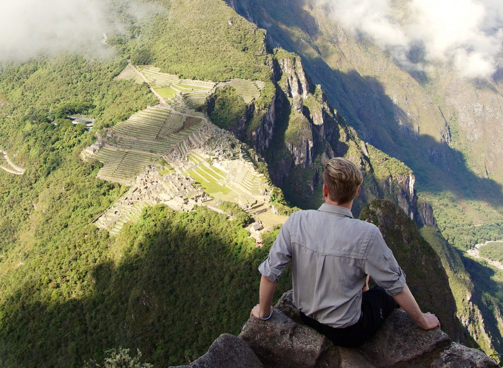 Me sitting ontop of the ruins after a long day from Cusco to Machu Picchu