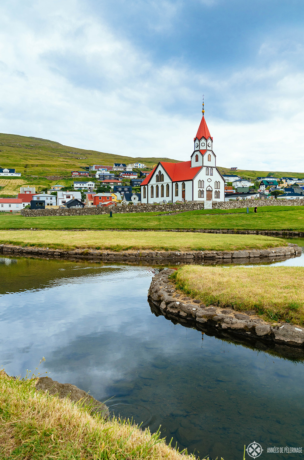 A colorful traditional wooden church in a smalltown in Iceland