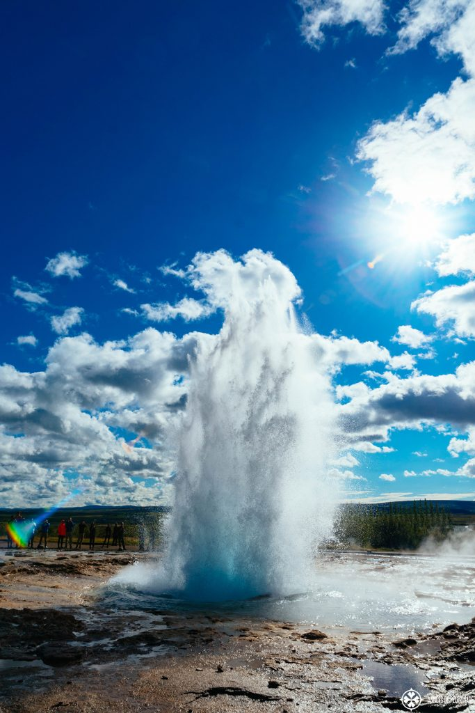 Strokkur geyser on the Golden Circle errupting - one of the many things you must see in Iceland
