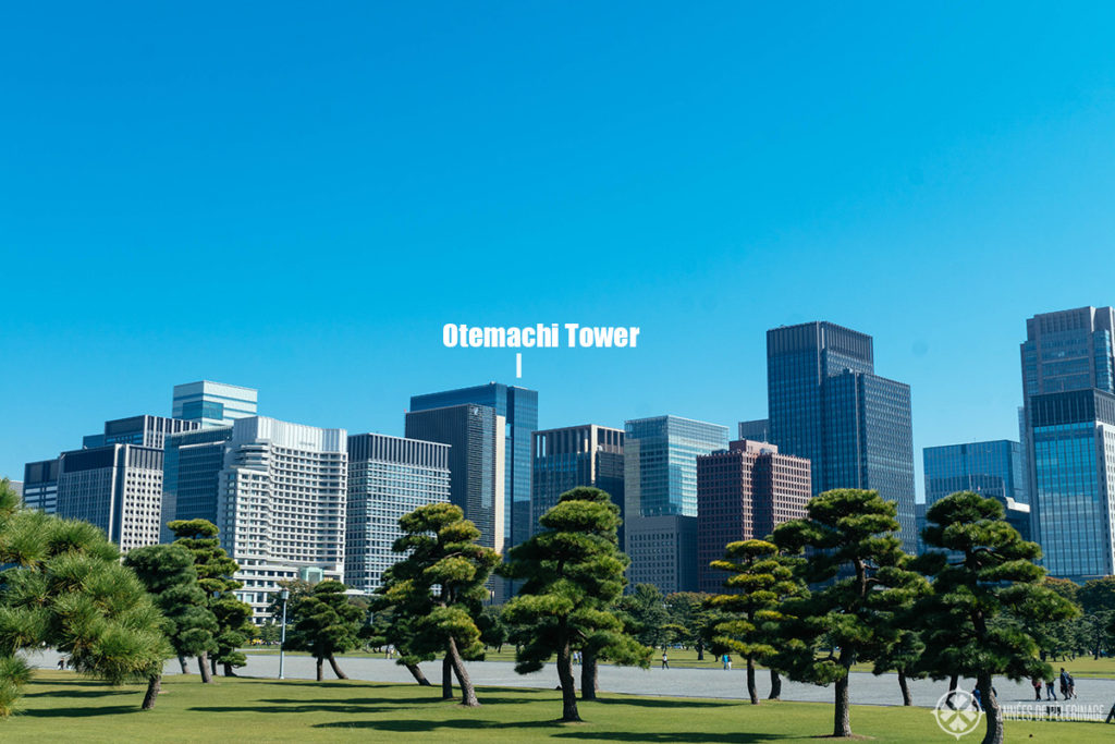 AMan Tokyo inside the Otematchi tower as seem from the gardens of the Imperial Palace