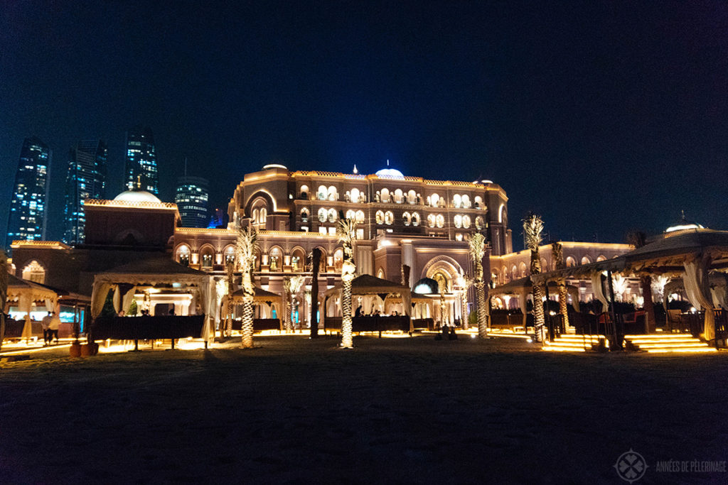 emirates palace hotel abu dhabi at night from the beach
