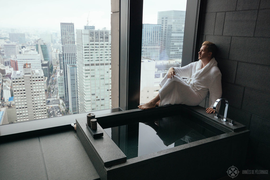 Me sitting in the bathroom and enjoying the view of Tokyo's chiyoda wards at the Aman Tokyo