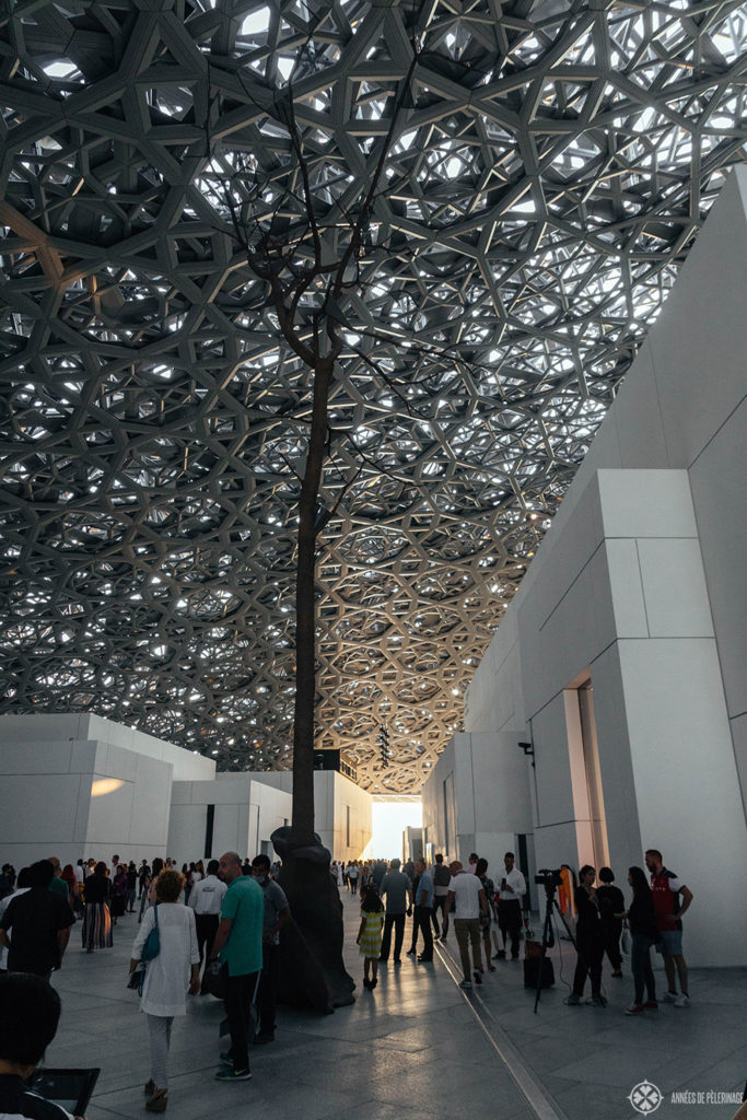 Looking at the gigantic dome metal mesh dome of the Louvre Abu Dhabi