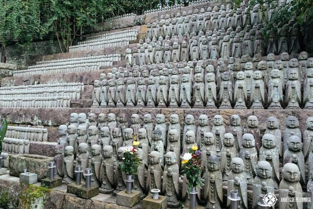 hundreds of small Jizō statues atHase-dera temple in Kamakura, Japan