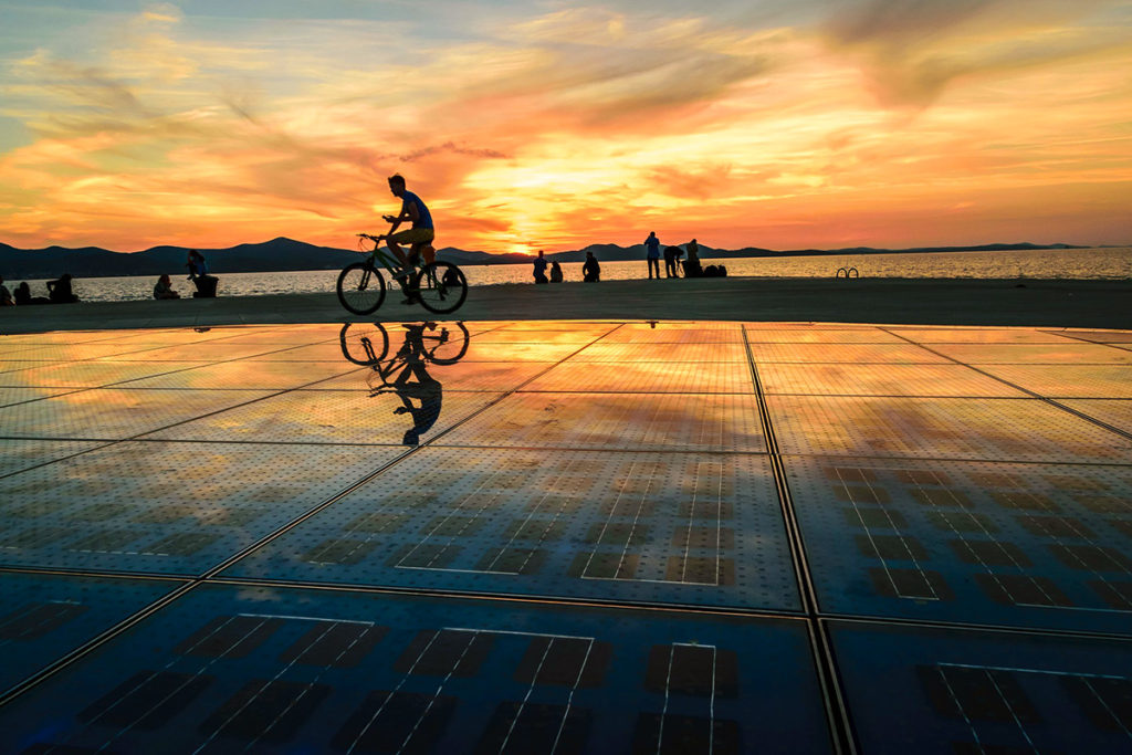 Sunset in zadar at the sun dial and sea organ