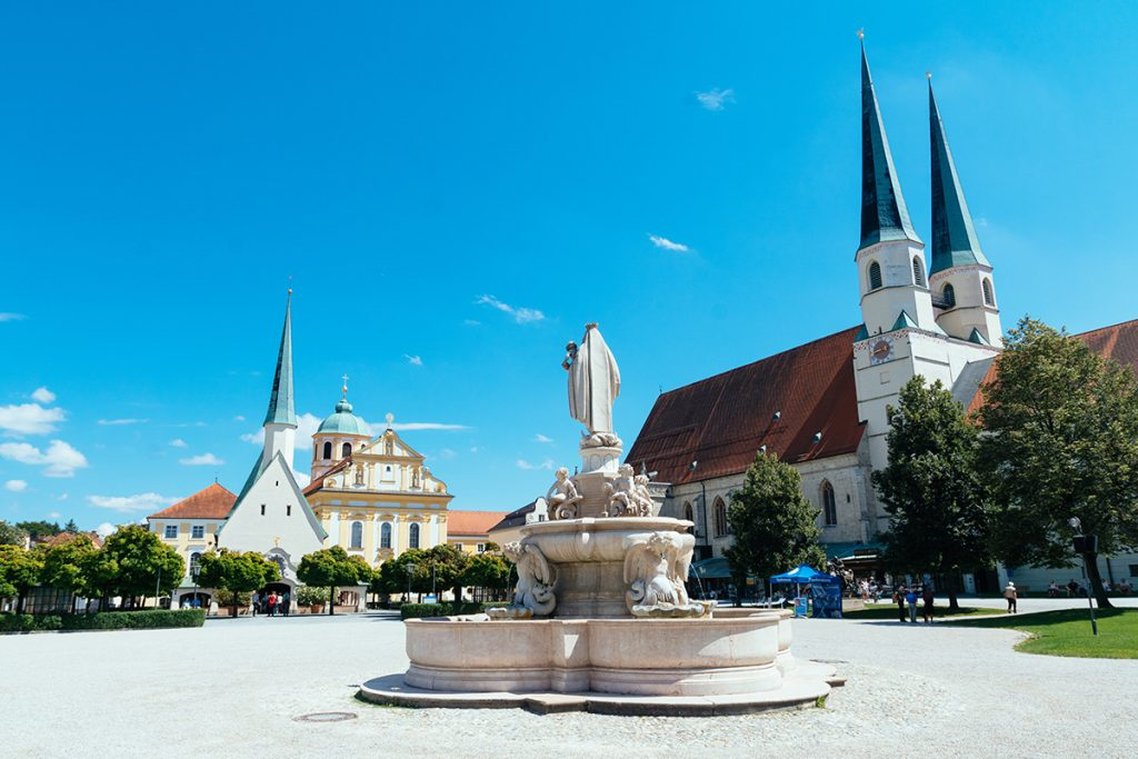 Central chapel square with a fountain in the foreground in Altöttingen, Germany