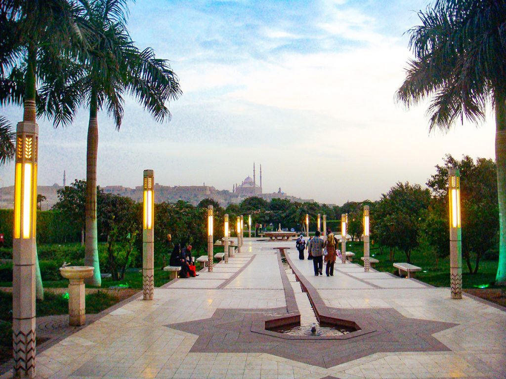 Al-Azhar park with views of the Cairo Citadel at dusk - one of the many free things to do in Cairo