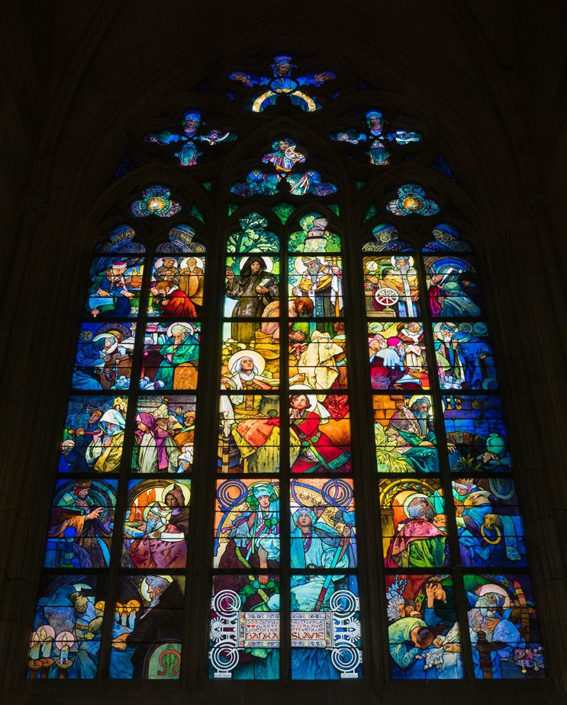 Stained glass window by Alphonse Mucha inside the St. Vitus Cathedral in Prague