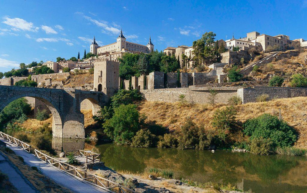 view of the ancient Puente de Alcántara in Toledo, Spain