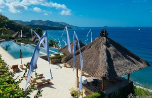 The amankila luxury hotel in East bali with its magnificient infinity pool all dressed up for a big celebration