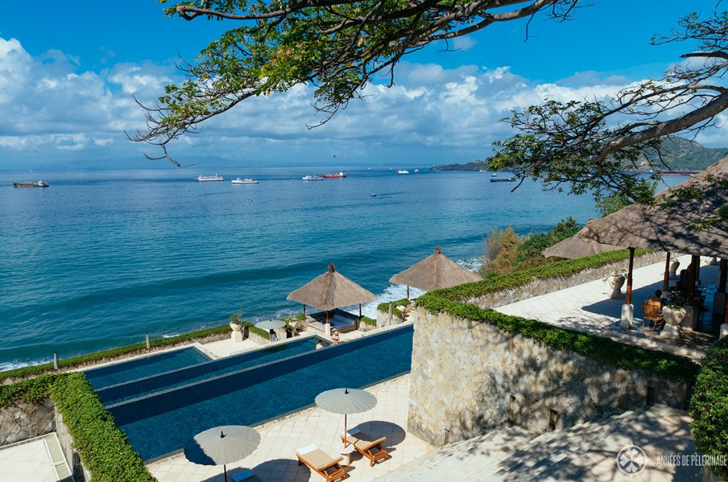 The view along the infinity pool and restaurant of the Amankila luxury hotel in East Bali
