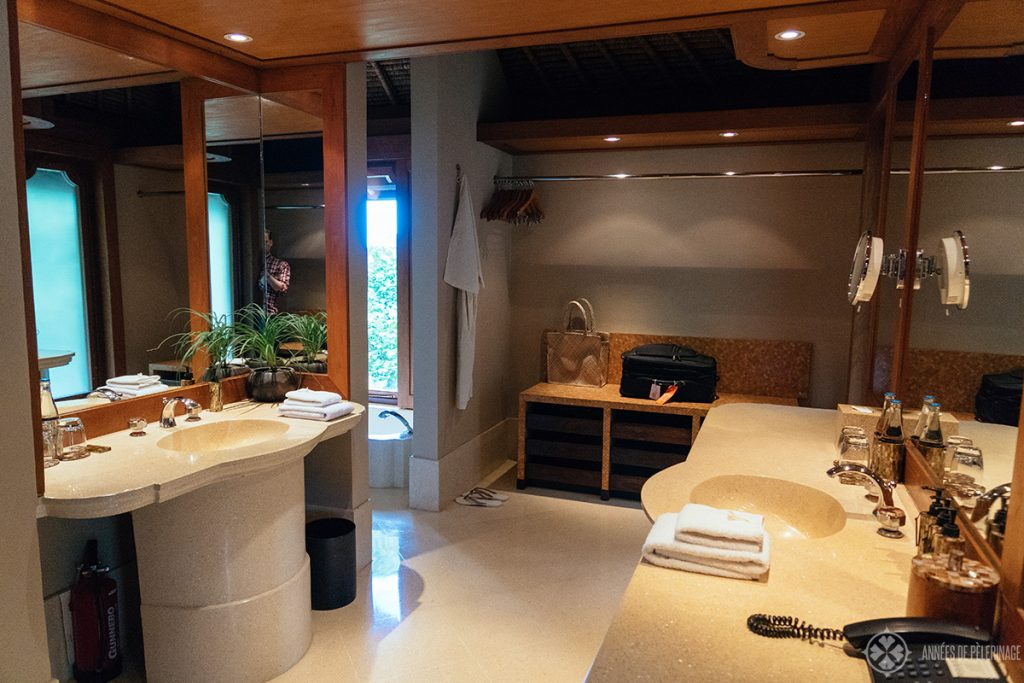 The bathroom of the Amankila luxury resort with two sinks and two dressing areas