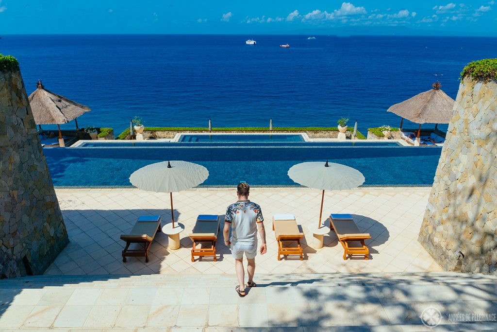 Walking down the stairs to the infinity pool of the Amankila luxury hotel in East Bali