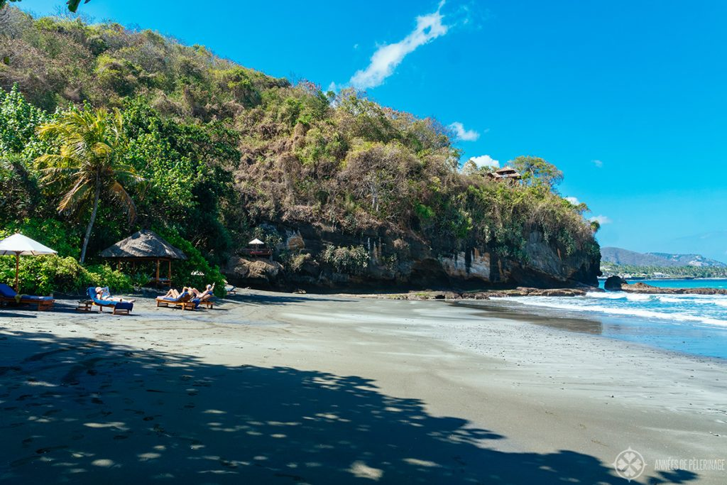 Private beach with Hindu temple on the cliff at the Amankila luxury hotel in East bali