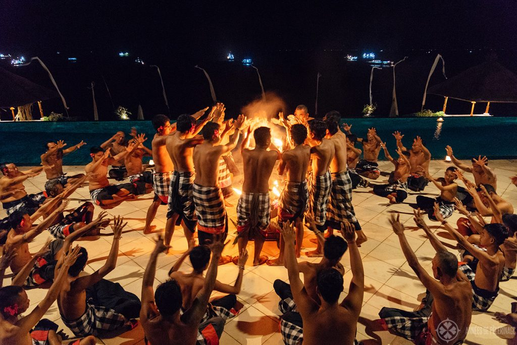 traditional Kecak dance performance at the infinity pool of the Amankila luxury resort